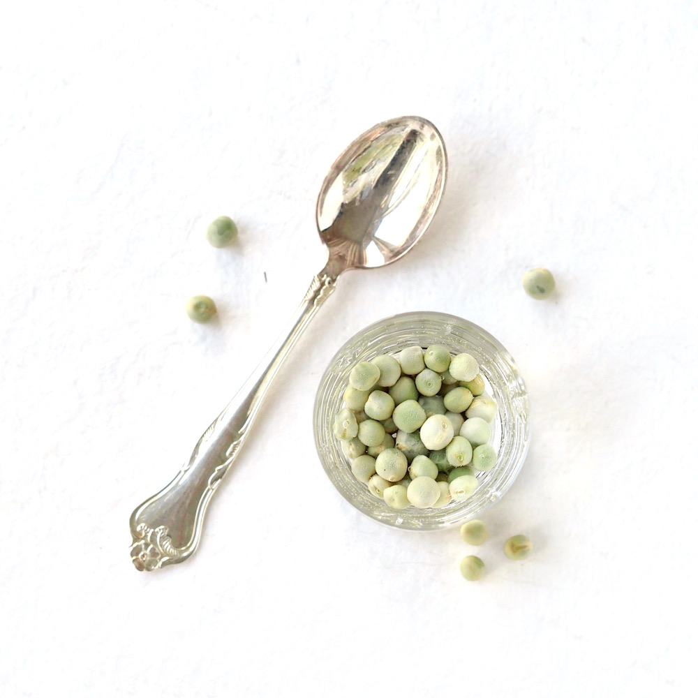 organic peas for sprouts soaking in water